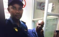 Screengrab of alleged rogue policemen at the Edenvale Police Station.