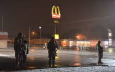 FILE: Members of the Missouri National Guard stand on patrol on West Florissant Avenue on 26 November, 2014 in Ferguson, Missouri. Picture: AFP.