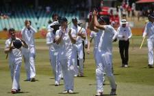 The England cricket team acknowledges the crowd at the end of the first Test match between South Africa and England at Kingsmead Stadium in Durban on 30 December 2015. Picture: AFP.
