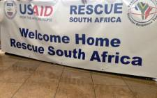 A welcome banner for the Rescue SA team which arrived at OR Tambo International Airport after their mission to the Philippines. Picture: Reinart Toerien/EWN.