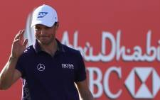 Martin Kaymer of Germany waves during the first day of the Abu Dhabi Golf Championship in the capital of the UAE on 15 January,2015. Picture: AFP.