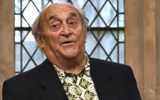 FILE: Anti-apartheid activist Denis Goldberg (R), poses with the certificate of his award of the Freedom of the City of London during a ceremony at the Guildhall in London on 7 January 2016. Picture: AFP