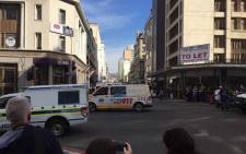 Emergency services at the scene of a robbery on Strand Street at Cash Crusaders in the Cape Town CBD. Picture: Ilze-Marie Le Roux/EWN