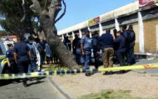 Police pictured on the scene where a man was killed in a shooting in Bonteheuwel. Picture: westerncapegangwatch.co.za