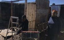 Masiphumelele resident Eugenia Siwela (R) said she couldn't wait for her place to be completed even though she needed furniture as hers was destroyed in the fire. Picture: Monique Mortlock/EWN.