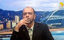 Screengrab of Andre du Plessis smoking a dagga joint during SABC's Newsroom interview on 11 May 2015.