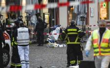 Police and ambulances work at the scene where a car drove into pedestrians in Trier, southwestern Germany, on 1 December 2020. Picture: AFP
