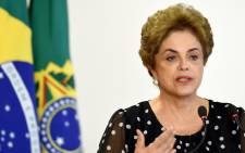 Brazilian President Dilma Rousseff attends a ceremony to renovate the leasing contract regarding the use of the Paranagua Container Terminal, at Planalto Palace in Brasilia, on 13 April, 2016. Picture: AFP.
