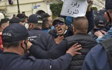 Algerian security forces prevent demonstrators to continue their march during an anti-government protest called by Algerian students on 2 March 2021 in Algiers. Picture: Ryad Kramdi/AFP