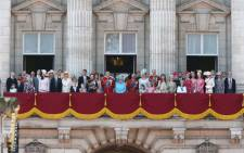 The Queen along with members of the British royal family watch RAF flypast from the balcony of Buckingham Palace. Picture: @RoyalFamily/Twitter.