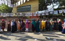 Bangladeshi voters wait in line outside a polling station in Dhaka on 30 December 2018. Bangladesh headed to the polls following a weeks-long campaign that was dominated by deadly violence and allegations of a crackdown on thousands of opposition activists. Picture: AFP