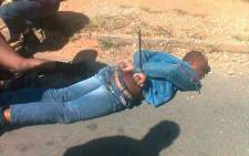 A suspected robber is arrested after a shootout on Rivonia Road in Morningside, north of Johannesburg on 22 April 2014. Picture: Isaac Mangena/iWitness.