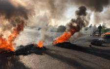 Residents burnt tyres and rubble in Ennerdale during protests for improved policing and job creation. Picture: EWN