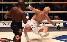 US boxing legend Floyd Mayweather Jr knocks down Kickboxer Tenshin Nasukawa of Japan during their exhibition match at Saitama Super Arena in Saitama on 31 December, 2018. Picture: AFP.