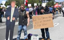 Two men sell eggs during a protest outside the Hyatt Regency Hotel where republican presidential candidate Donald Trump was speaking in Burlingame, California on 29 April, 2016. Picture: AFP.