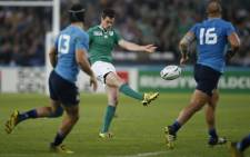FILE: Ireland flyhalf Jonathan Sexton kicks the ball during a Pool D match of the 2015 Rugby World Cup between Ireland and Italy at the Olympic Stadium, east London, on 4 October 2015. Picture: AFP.