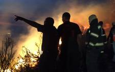 Firefighters are seen on 2 February after a blaze broke out near Du Toitskloof Pass. Picture: Kevin Brandt/EWN.