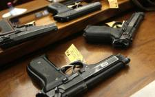 Guns are used as an exhibit in A Johannesburg court. Picture: SAPA
