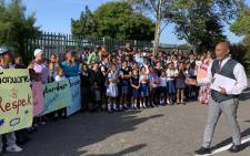 Principal Aleem Abrahams, teachers and parents protest at Bergville Primary School over a range of challenges, including gang violence and substance abuse. Picture: Kaylynn Palm/EWN.