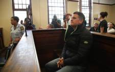 Jason Rohde sits down after entering the dock in the Stellenbosch Magistrate's Court on 26 August 2016. Picture: Aletta Harrison/EWN.