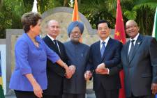 Caption: (L-R) Brazilian President Dilma Roussef, Russian President Vladimir Putin,Indian Prime Minister Manmohan Singh, Chinese President Hu Jintao and South African President Jacob Zuma pose for group photo in Los Cabos, Mexico, June 18, 2012, during a BRICS's Presidents meeting before the opening of the G20 leaders Summit. Source: AFP