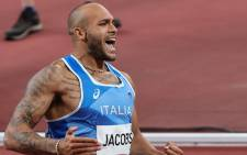 Italy's Lamont Marcell Jacobs celebrates after winning the men's 100m final during the Tokyo 2020 Olympic Games at the Olympic Stadium in Tokyo on August 1, 2021. Picture: Giuseppe CACACE / AFP
