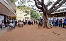 People queue at a polling station in Maputo on 15 October 2014. Picture: EPA.