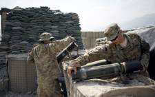 FILE: Soldiers of the 4th brigade combat team 4th infantry division of the U.S. Army clean a mortar range at the Forward Operating Base Joyce, in the Kunar province of Afghanistan. Picture: AFP.