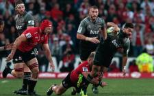 Lions' Ruan Dreyer (2nd L) tackles Crusaders' Richie Mo'unga during the Super XV rugby final match between Lions and Crusaders at Ellis Park Rugby stadium on 5 August 2017 in Johannesburg. Picture: AFP.