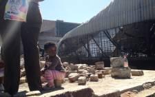 Children were left stranded after the factory fire in Marlboro, Johannesburg, on 1 September, 2012. Picture: Govan Whittles/EWN.