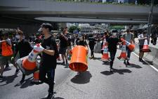 Protesters occupy a main road outside the government headquarters in Hong Kong on 21 June 2019. Picture: AFP
