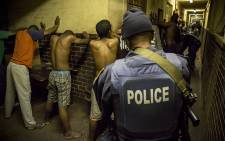 Police detain and search hostel dwellers in Jeppestown during a joint raid with Saps and SANDF after recent violent flare-ups in the Johannesburg central district. Picture: Thomas Holder/EWN