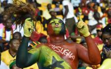A Ghana supporter cheers his team ahead of the 2015 African Cup of Nations semi-final match between Equatorial Guinea and Ghana. Picture: AFP