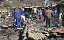 File Picture: Shacks devastated by fire. Picture: Tshidi Madia/EWN
