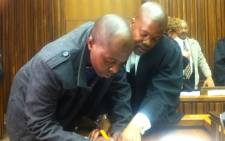 Student Constable Sipho Mbatha and his attorney Kenneth Mayaga. Picture: Theo Nkonki/EWN.