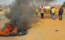 Violent protests erupted in Ennerdale as angry residents demanded demanding houses. Picture: Louise McAuliffe/EWN.