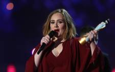 British singer Adele reacts after receiving the British female solo artist award during the Brit Awards 2016 in London on 24 February 2016. Picture: AFP.