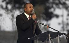 FILE: Ethiopian Prime Minister Abiy Ahmed addresses guests in Addis Ababa Meskel Square, on 13 June 2021, during the official inauguration of the city's landmark. Picture: EDUARDO SOTERAS/AFP