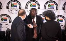 ANC President Cyril Ramaphosa (centre) greets evidence leader Advocate Paul Pretorius (left) at the Zondo commission of inquiry into state capture on 28 April 2021. Picture: Xanderleigh Dookey Makhaza/Eyewitness News
