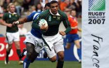 FILE: Springbok winger Bryan Habana runs in to score a try at the 2007 Rugby World Cup. Picture: AFP