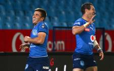 The Bulls' Johan Goosen (right) celebrates a try. Picture: @BlueBullsRugby/Twitter
