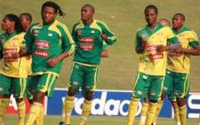 Macbeth Sibaya (wearing sweater, front left), Teko Modise (front right) and their Bafana teammates warm up for training