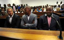 Business associates (from left) Kagisho Dichabe, Lesiba Gwangwa and Makgetsi Manthatha of axed ANC Youth League leader Julius Malema appear in the Polokwane Magistrate's Court on Tuesday, 25 September 2012. Picture: Werner Beukes/SAPA.