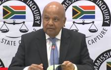 A screengrab of Public Enterprises Minister Pravin Gordhan appearing at the Zondo commission of inquiry on 19 November 2018.