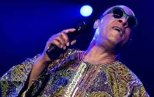 FILE: The African-American singer and songwriter, wearing lime green sunglasses and braids down to his waist, headlined the 48th edition of the prestigious Swiss festival. Picture: AFP.