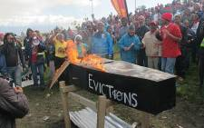 Manenberg residents burn their municipal bills on 23 May 2012. Picture: Shamiela Fisher/EWN