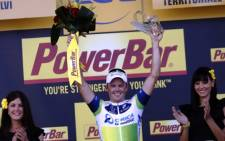Stage winner Australia's Simon Gerrans celebrates on the podium at the end of the 145.5 km third stage of the 100th edition of the Tour de France cycling race on 1 July, 2013 between Ajaccio and Calvi, on the French Mediterranean Island of Corsica. Picture: AFP/ Jeff Pachoud