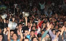 Moroccans bang on pots as they gather in the northern city of al-Hoceima on May 6, 2017, during a demonstration that involved banging on pots as a new form of protest. Outrage has erupted in late 2016 in the Rif region of Morocco over the gruesome death of a 31-year-old fishmonger, who was crushed in a rubbish truck in October in al-Hoceima as he tried to protest against the seizure and destruction of swordfish, which were not allowed to be caught at that time of year. Calls for justice have since evolved into a grassroots movement demanding jobs and hospitals. Picture: AFP.