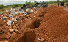 FILE: Open graves at a cemetery. Picture: Boikhutso Ntsoko/Eyewitness News