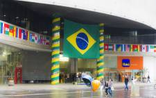 A shopping centre in Sao Paulo decorated with flags from the countries participating in the world cup. Picture: Christa Eybers/EWN